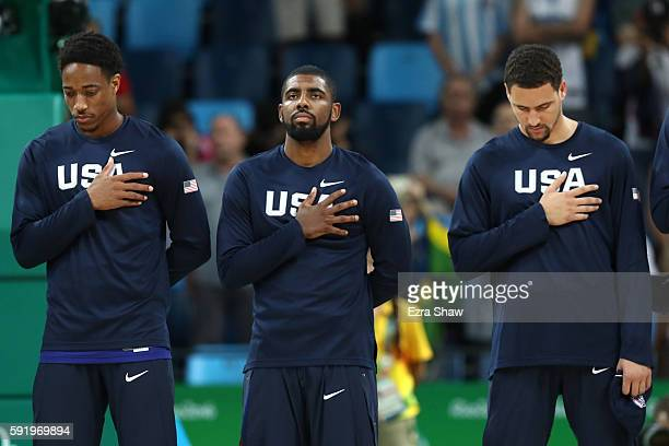 Demar DeRozan Kyrie Irving and Klay Thompson of United States stand for the national anthem prior to the Men's Semifinal match against Spain on Day...