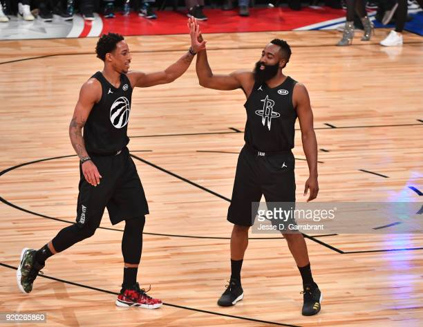 DeMar DeRozan of Team Curry gives James Harden a high five against Team LeBron during the NBA AllStar Game as a part of 2018 NBA AllStar Weekend at...