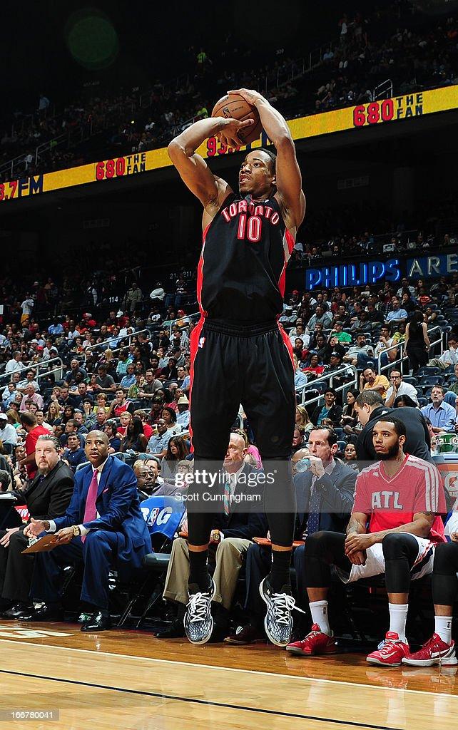 DeMar DeRozan #10 of the Atlanta Hawks shoots a three pointer against the Toronto Raptors on April 16, 2013 at Philips Arena in Atlanta, Georgia.