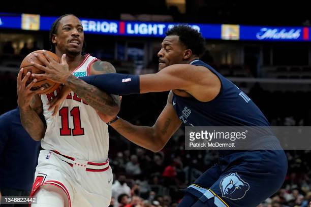 DeMar DeRozan of the Chicago Bulls drives to the basket against Xavier Tillman Sr. #2 of the Memphis Grizzlies in the first half during a preseason...
