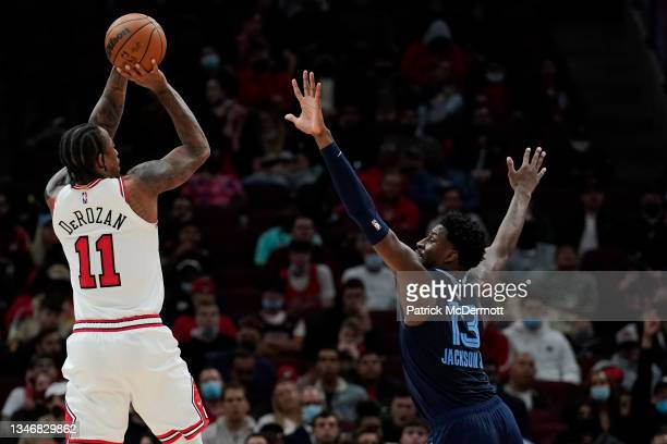 DeMar DeRozan of the Chicago Bulls shoots the ball against Jaren Jackson Jr. #13 of the Memphis Grizzlies in the second half during a preseason game...