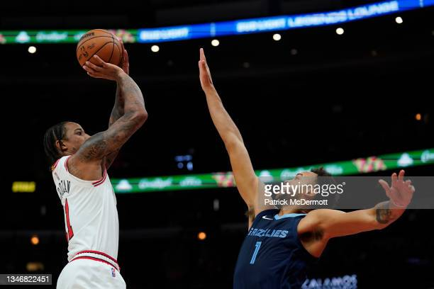 DeMar DeRozan of the Chicago Bulls shoots the ball against Kyle Anderson of the Memphis Grizzlies in the first half during a preseason game at United...