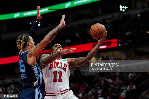 DeMar DeRozan of the Chicago Bulls shoots the ball against Sam Merrill of the Memphis Grizzlies in the first half during a preseason game at United...
