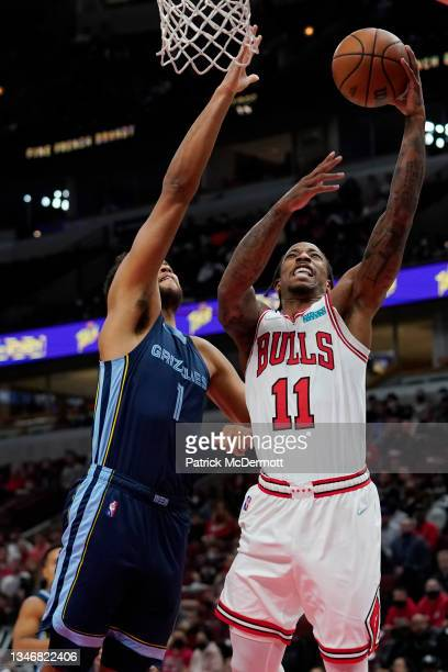 DeMar DeRozan of the Chicago Bulls shoots the the ball against Kyle Anderson of the Memphis Grizzlies in the first half during a preseason game at...