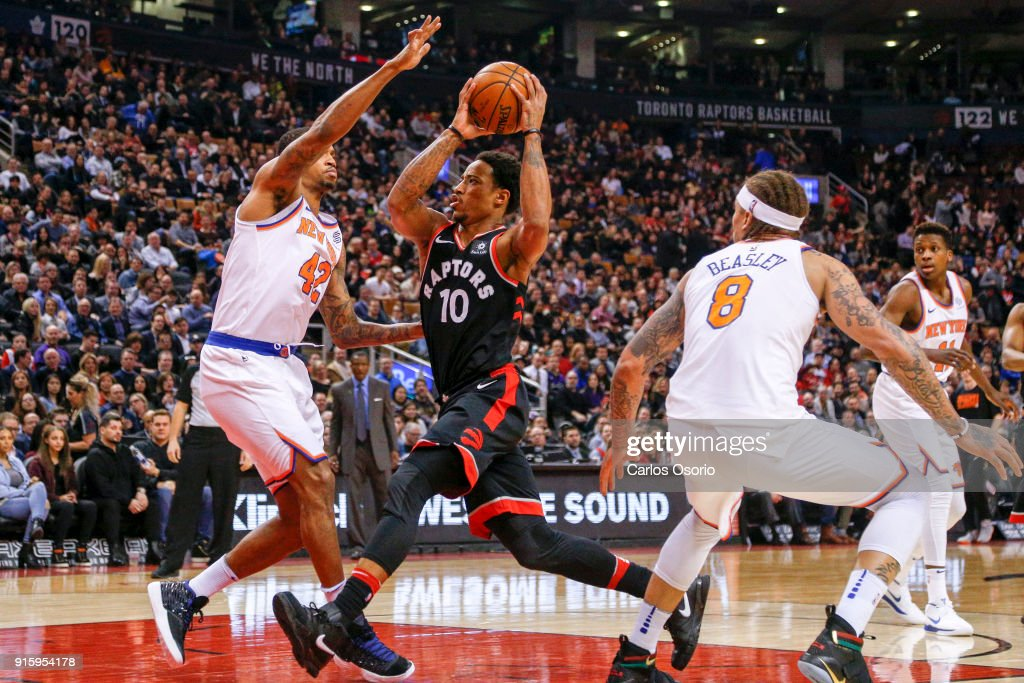 TORONTO, ON - FEBRUARY 8 - DeMar DeRozan (10) of the Raptors drives to the net past Lance Thomas (42) and Michael Beasley (8) of the Knicks during the 1st half of NBA action as the Toronto Raptors host the New York Knicks at the Air Canada Centre on February 8, 2018.