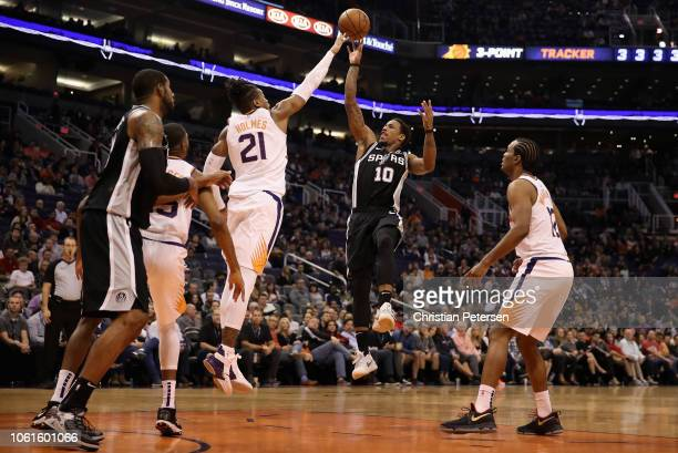 DeMar DeRozan of the San Antonio Spurs attempts a shot over Richaun Holmes of the Phoenix Suns during the second half of the NBA game at Talking...
