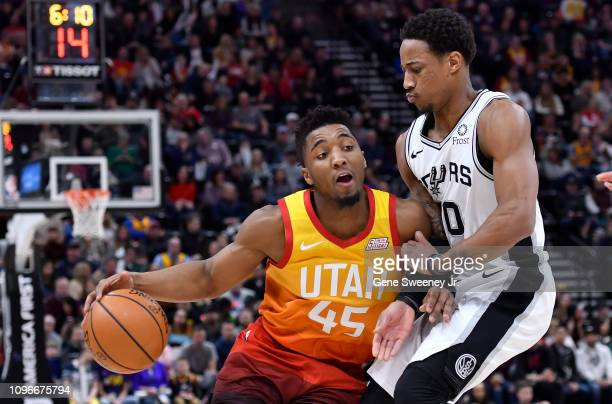 DeMar DeRozan of the San Antonio Spurs defends against Donovan Mitchell of the Utah Jazz in the first half of a NBA game at Vivint Smart Home Arena...