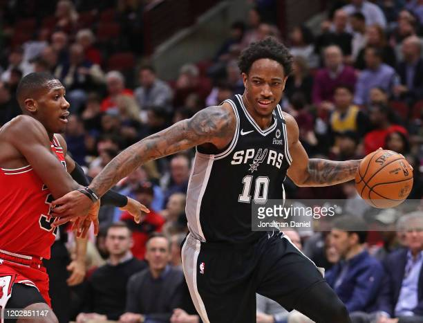 DeMar DeRozan of the San Antonio Spurs drives around Kris Dunn of the Chicago Bulls at the United Center on January 27, 2020 in Chicago, Illinois....