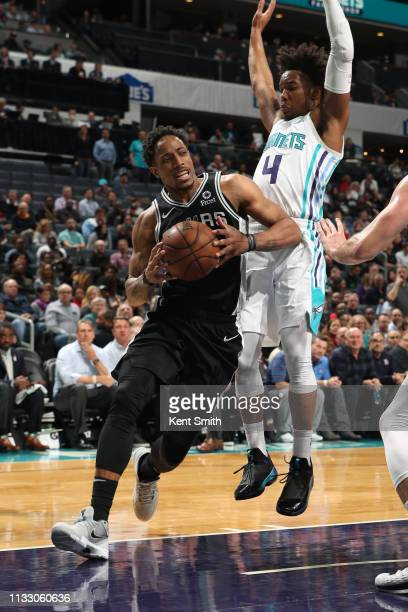DeMar DeRozan of the San Antonio Spurs drives to the basket against the Charlotte Hornets on March 26 2019 at the Spectrum Center in Charlotte North...