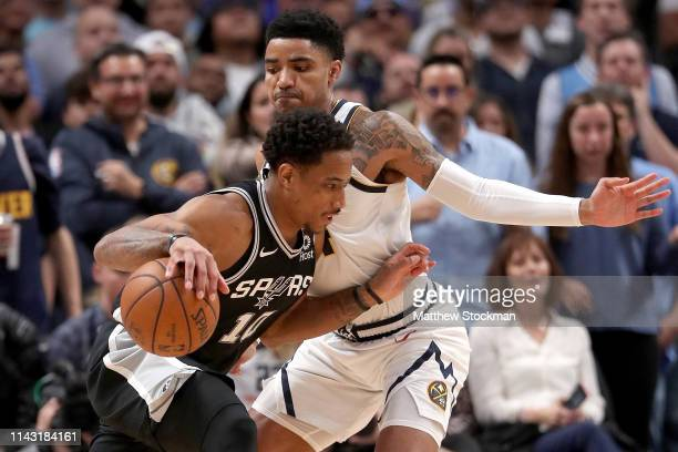 Demar DeRozan of the San Antonio Spurs drives to the basket against Gary Harris of the Denver Nuggets in the fourth quarter during game two of the...