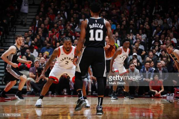 DeMar DeRozan of the San Antonio Spurs handles the ball against Kawhi Leonard of the Toronto Raptors on February 22 2019 at the Scotiabank Arena in...