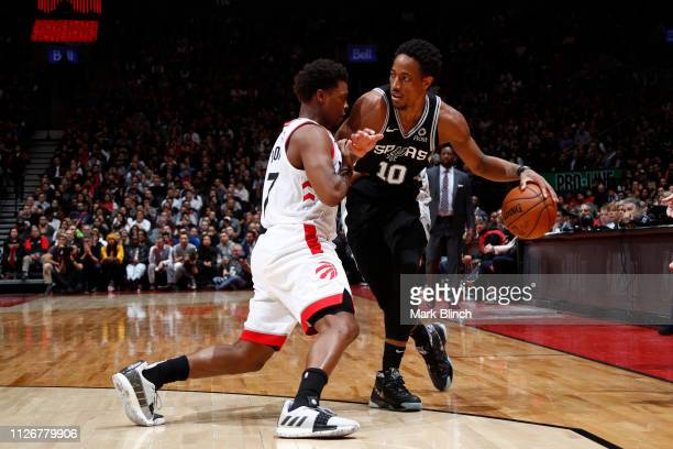 DeMar DeRozan of the San Antonio Spurs handles the ball against Kyle Lowry of the Toronto Raptors on February 22 2019 at the Scotiabank Arena in...