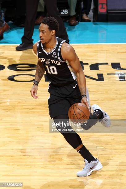 DeMar DeRozan of the San Antonio Spurs handles the ball against the Charlotte Hornets on March 26 2019 at the Spectrum Center in Charlotte North...