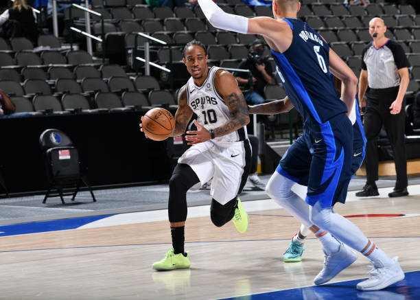 DeMar DeRozan of the San Antonio Spurs handles the ball against the Dallas Mavericks on March 10, 2021 at the American Airlines Center in Dallas,...