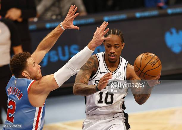 DeMar DeRozan of the San Antonio Spurs passes as Blake Griffin of the Brooklyn Nets defends in the first quarter at Barclays Center on May 12, 2021...