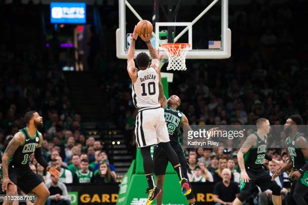DeMar DeRozan of the San Antonio Spurs shoots against Terry Rozier III of the Boston Celtics at TD Garden on March 24 2019 in Boston Massachusetts...