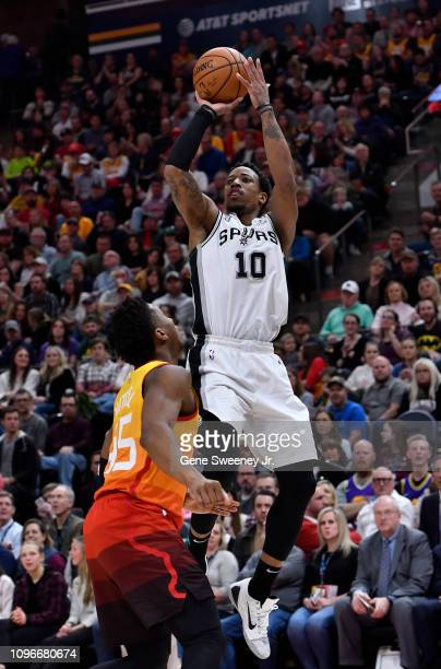 DeMar DeRozan of the San Antonio Spurs shoots over Donovan Mitchell of the Utah Jazz in the second half of a NBA game at Vivint Smart Home Arena on...