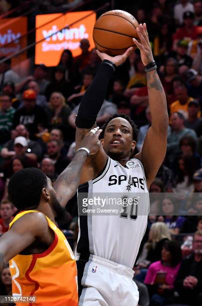 DeMar DeRozan of the San Antonio Spurs shoots over Royce O'Neale of the Utah Jazz in a NBA game at Vivint Smart Home Arena on February 09 2019 in...