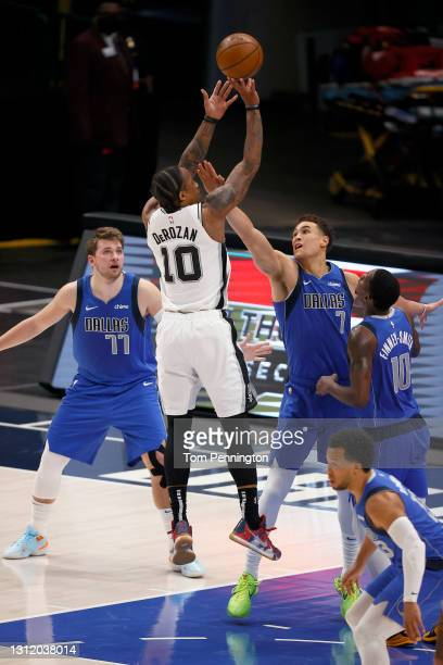 DeMar DeRozan of the San Antonio Spurs shoots the ball against Dwight Powell of the Dallas Mavericks in the second half at American Airlines Center...
