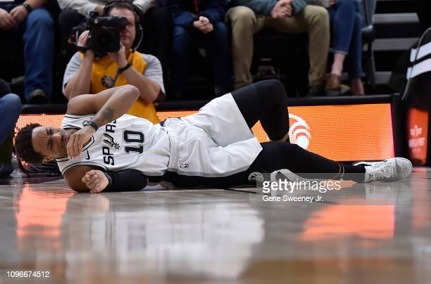 DeMar DeRozan of the San Antonio Spurs stays down on the court after slipping while shooting in the first half of a NBA game against the Utah Jazz at...