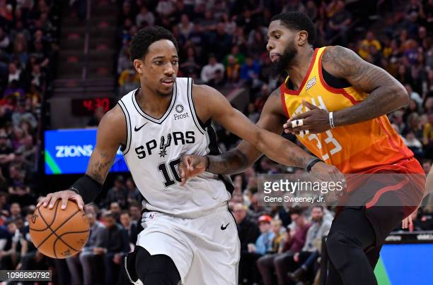 DeMar DeRozan of the San Antonio Spurs tries to drive around Royce O'Neale of the Utah Jazz in the second half of a NBA game at Vivint Smart Home...