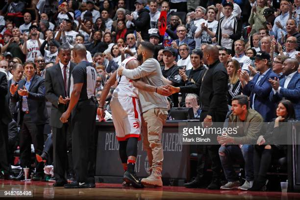 DeMar DeRozan of the Toronto Raptors and Drake hug during the game against the Washington Wizards in Game Two of Round One of the 2018 NBA Playoffs...
