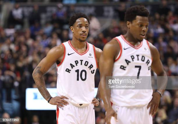 DeMar DeRozan of the Toronto Raptors and Kyle Lowry look on during their NBA game against the Detroit Pistons at Air Canada Centre on February 26...