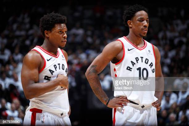 DeMar DeRozan of the Toronto Raptors and Kyle Lowry of the Toronto Raptors look on during the game against the Washington Wizards in Game Two of...