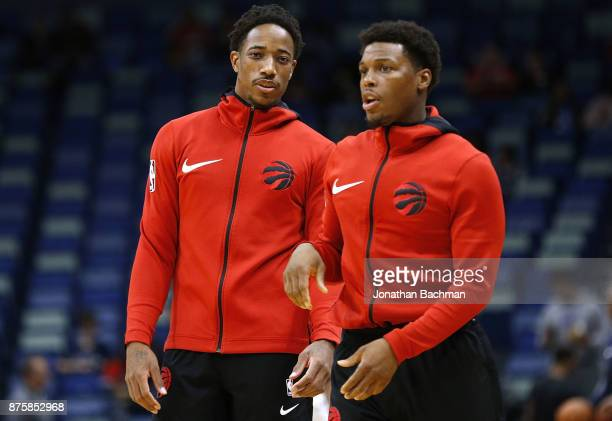 DeMar DeRozan of the Toronto Raptors and Kyle Lowry warm up before a game against the New Orleans Pelicans at the Smoothie King Center on November 15...