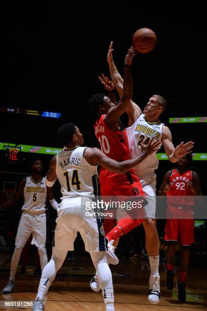 DeMar DeRozan of the Toronto Raptors and Richard Jefferson of the Denver Nuggets vie for the ball during the game on November 1 2017 at the Pepsi...