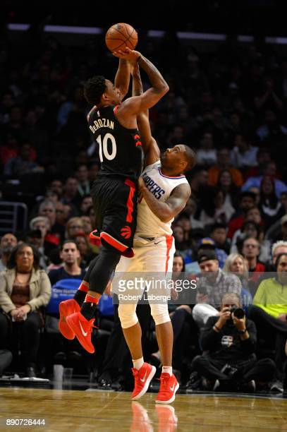 DeMar DeRozan of the Toronto Raptors attempts a jump shot against Sindarius Thornwell of the Los Angeles Clippers on December 11 2017 at STAPLES...