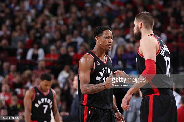 DeMar DeRozan of the Toronto Raptors celebrates a play with Jonas Valanciunas of the Toronto Raptors against the Portland Trail Blazers on February 4...