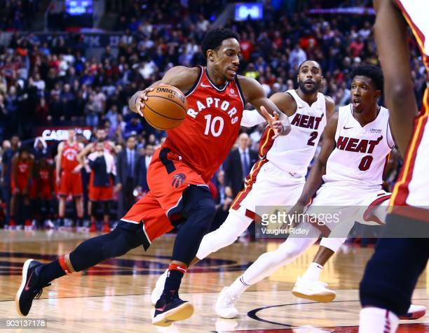DeMar DeRozan of the Toronto Raptors dribble the ball as Josh Richardson of the Miami Heat defends during the second half of an NBA game at Air...