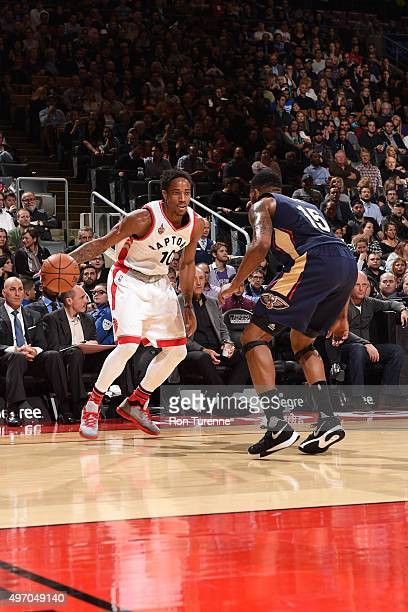 DeMar DeRozan of the Toronto Raptors dribbles the ball against Alonzo Gee of the New Orleans Pelicans on November 13 2015 at the Air Canada Centre in...
