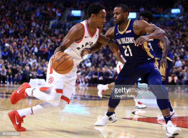 DeMar DeRozan of the Toronto Raptors dribbles the ball as Darius Miller of the New Orleans Pelicans defends during the second half of an NBA game at...