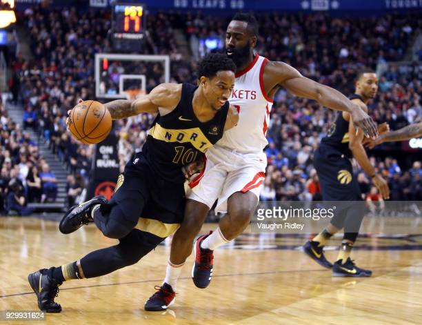 DeMar DeRozan of the Toronto Raptors dribbles the ball as James Harden of the Houston Rockets defends during the second half of an NBA game at Air...
