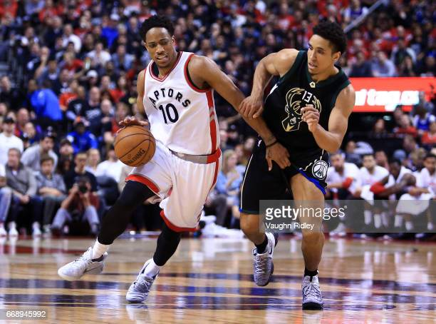 DeMar DeRozan of the Toronto Raptors dribbles the ball as Malcolm Brogdon of the Milwaukee Bucks defends in the second half of Game One of the...