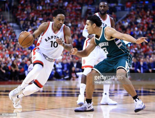 DeMar DeRozan of the Toronto Raptors dribbles the ball as Malcolm Brogdon of the Milwaukee Bucks defends in the second half of Game Two of the...