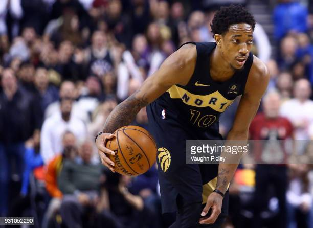 DeMar DeRozan of the Toronto Raptors dribbles the ball during the second half of an NBA game against the Houston Rockets at Air Canada Centre on...