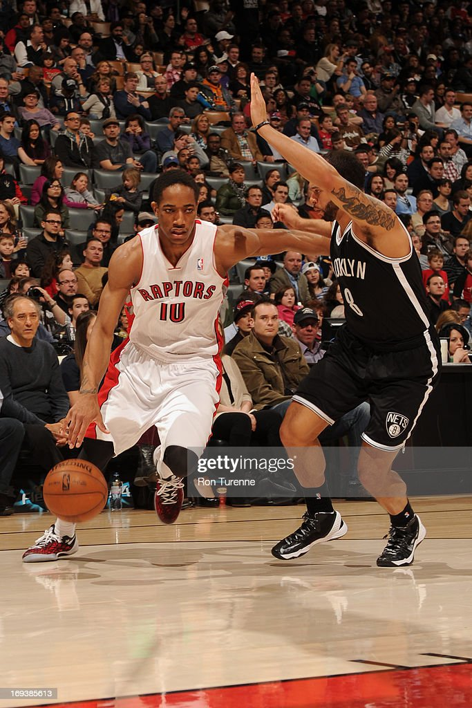 DeMar DeRozan #10 of the Toronto Raptors dribbles to the basket against the Brooklyn Nets during the game on April 14, 2013 at the Air Canada Centre in Toronto, Ontario, Canada.