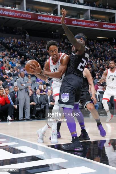 DeMar DeRozan of the Toronto Raptors drives against JaKarr Sampson of the Sacramento Kings on December 10 2017 at Golden 1 Center in Sacramento...