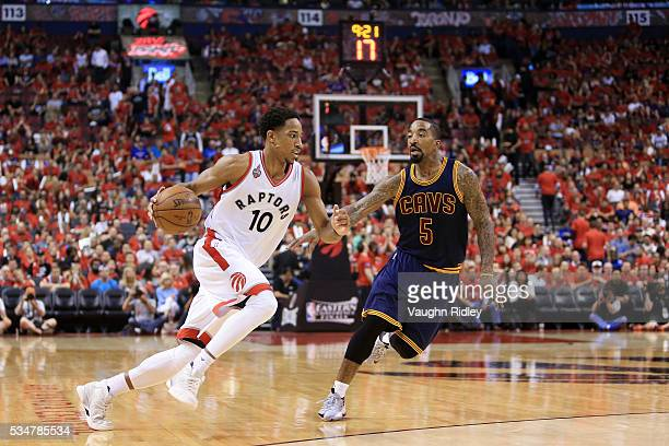 DeMar DeRozan of the Toronto Raptors drives against JR Smith of the Cleveland Cavaliers in the third quarter in game six of the Eastern Conference...