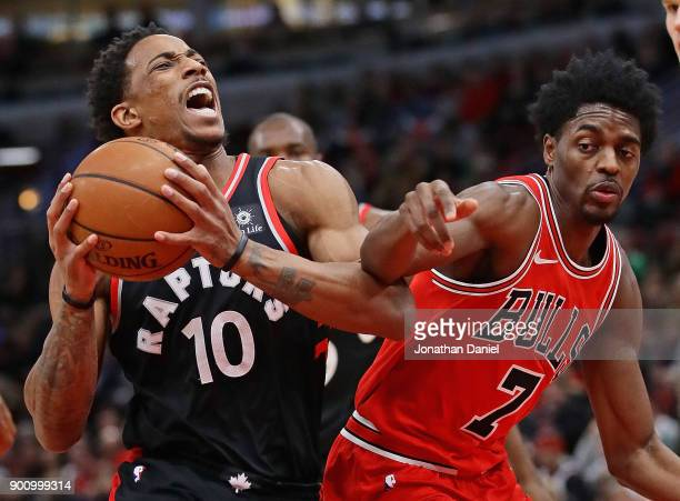 DeMar DeRozan of the Toronto Raptors drives against Justin Holiday of the Chicago Bulls at the United Center on January 3 2018 in Chicago Illinois...