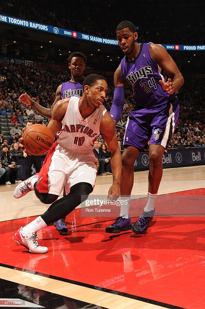 DeMar DeRozan #10 of the Toronto Raptors drives against the Sacramento Kings on March 7, 2014 at the Air Canada Centre in Toronto, Ontario, Canada.
