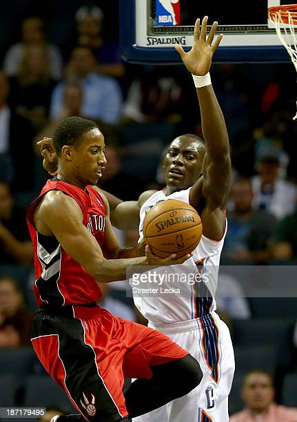 DeMar DeRozan of the Toronto Raptors drives past Bismack Biyombo of the Charlotte Bobcats during their game at Time Warner Cable Arena on November 6...