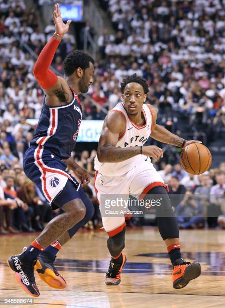 DeMar DeRozan of the Toronto Raptors drives the ball against John Wall of the Washington Wizards in Game Two of the Eastern Conference First Round in...