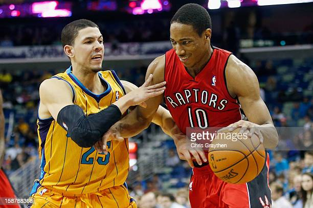DeMar DeRozan of the Toronto Raptors drives the ball around Austin Rivers of the New Orleans Hornets at New Orleans Arena on December 28 2012 in New...
