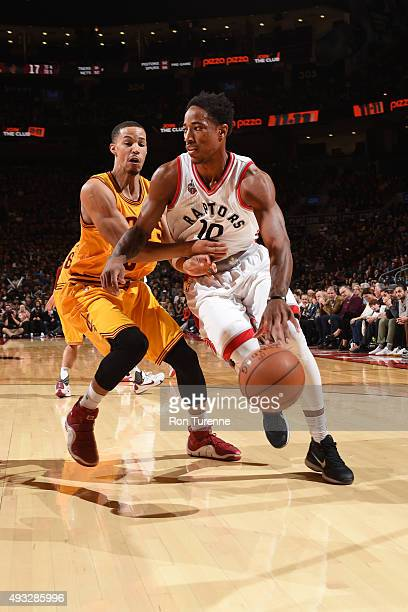 DeMar DeRozan of the Toronto Raptors drives to the basket against Jared Cunningham of the Cleveland Cavaliers during the game on October 18 2015 at...