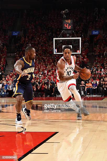 DeMar DeRozan of the Toronto Raptors drives to the basket against Rodney Stuckey of the Indiana Pacers in Game Seven of the Eastern Conference...