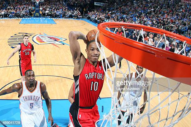 DeMar DeRozan of the Toronto Raptors drives to the basket against the Oklahoma City Thunder on December 22, 2013 at the Chesapeake Energy Arena in...